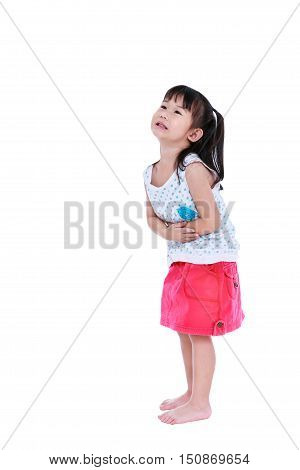 Asian Child In Pink Skirt Suffering From Stomachache. Isolated On White
