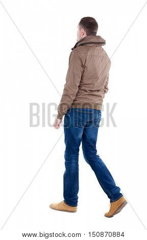 Back view of going  handsome man in brown wind breaker. walking young guy . Rear view people collection.  backside view of person.  Isolated over white background.