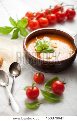 Homemade tomato soup with basil and parmesan