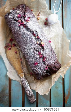 Homemade chocolate banana loaf with dried roses