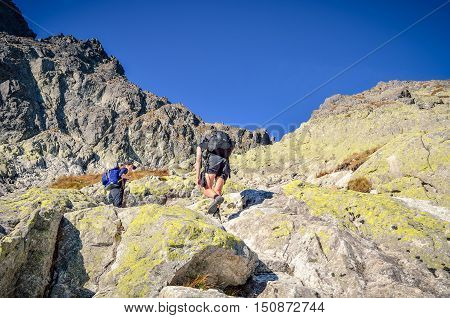 HIGH TATRA MOUNTAINS SLOVAKIA - SEPTEMBER 15 2016: Tourist on a rocky trail in High Tatra Mountains Slovakia.