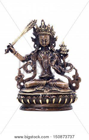 Statuette of Manjushri brandishing sword of wisdom on a white background. Manjushri Still a Youth. Vajrayana deity.