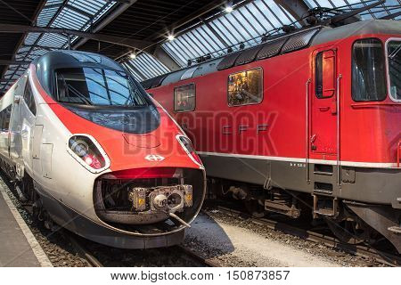 Zurich, Switzerland - 9 October, 2016: trains at Zurich main railway station. Zurich main railway station (German: Zurich Hauptbahnhof or Zurich HB) is the largest railway station in Switzerland and one of the busiest railway stations in the world.