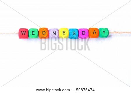 WEDNESDAY word of multicolored cubes on a white background