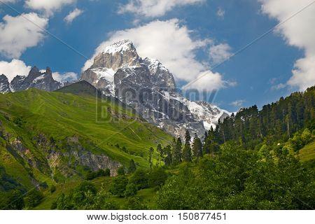 Sunny morning scene with Caucasus mountains. Svanetia, Georgia