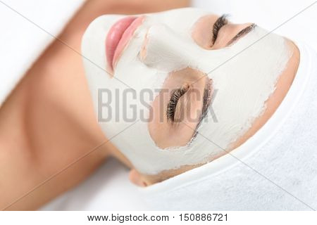 Close up of relaxed young woman sleeping with facial mask