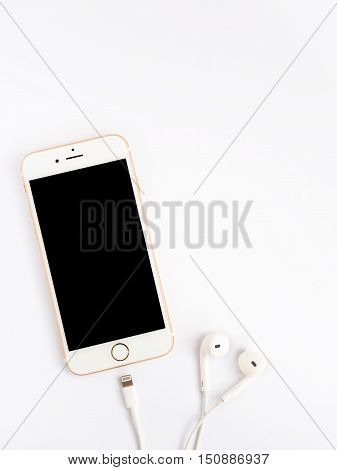 CHIANGRAI THAILAND -SEPTEMBER 9 2016: Front view of new Apple iPhone 7 mockup and new Apple EarPods mockup on white background with copy space.