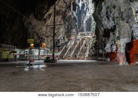 Kuala Lumpur, Malaysia - circa August 2016: Inside of the batu cave in the north of Kuala Lumpur Malaysia. Batu Caves is a limestone hill that has a series of caves and cave temples near Kuala Lumpur.