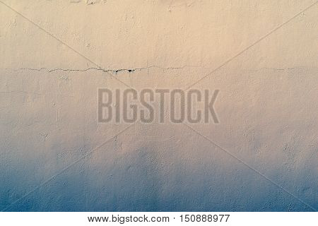 the abstract textured background of an old surface of the plastered wall of a motley color tonality