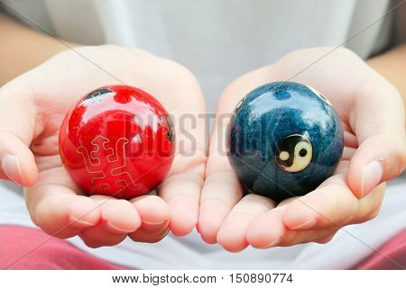 Chinese Zen Balls. Yin Yang Balls, Chinese zen balls red and blue. Chinese zen balls isolated on white. Two Chinese zen balls yin and yang