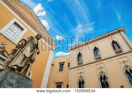 Nicola Pisano statue with Santa Maria del Carmine church in the background Pisa