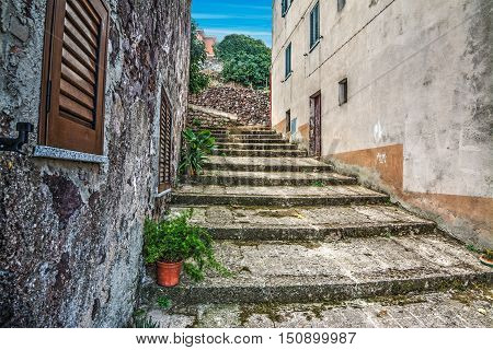 old rustic stairs in Sardinia in Italy