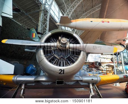 BRUSSELS-OCT. 1: An antique historic North American T-6 propeller fighter airplane is seen on display at The Royal Museum of the Armed Forces and Military History in Cinquantenaire Park in Brussels Belgium Europe on October 1 2015.