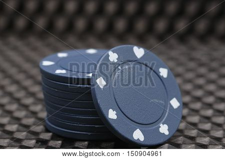 A stack of blue poker chips  isolated on a black background