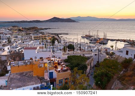 NAXOS, GREECE - SEPTEMBER 23, 2016: View of the old town of Naxos and its port from the castle on September 23, 2016.