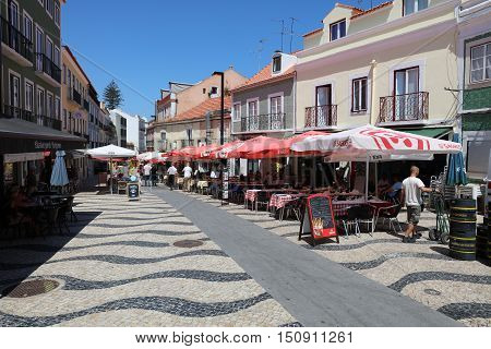 Cacilhas, Portugal - July 28, 2016:  Small Town Cacilhas in District Almada near Lisbon in Portugal. From here you can Start a Trip tot he Cristo Statue. A popular Place for Tourists and local People.
