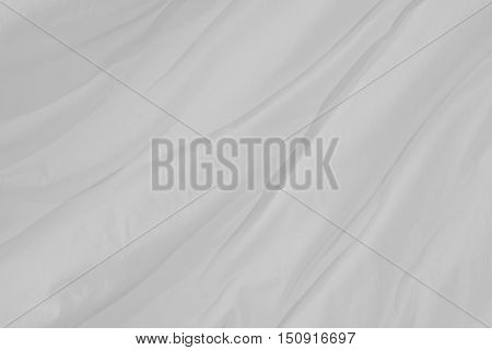 Top view of bedding sheets crease, white fabric texture