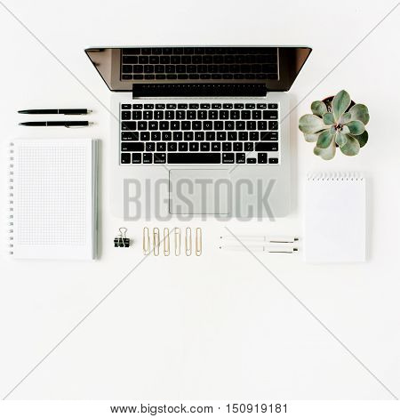 Flat lay top view office table desk. Workspace with laptop diary succulent and glasses on white background.
