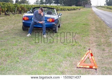 Motorist Broken Down On Country Road Waiting For Help