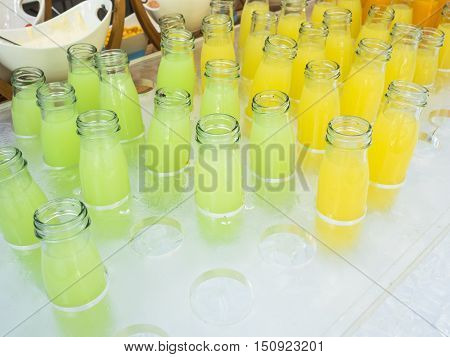 Fresh guava juice and pineapple juice in bottles glass.