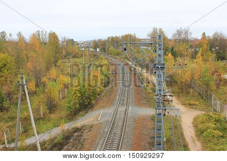 Rail road train track path way rural landscape. Transit transportation industrial background colorful autumn fall. Life at the countryside or small village, park, travel, trip concept.