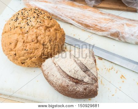 Fresh homemade brown bread on the table.