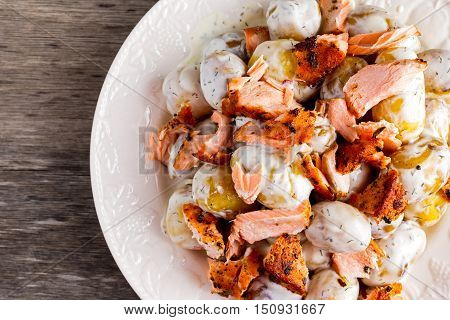Salmon and young potato warm salad with a lemony yogurt dressing.