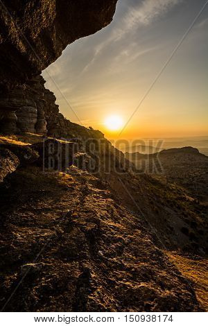 Sunset on the edge of a cliff in the Torcal de Antequera, Málaga, Spain