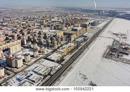 Tyumen, Russia - March 10, 2016: Aerial view on 2nd Tyumen residential district, Island shopping center, Yamal residential district and construction site with heat and power factory on background