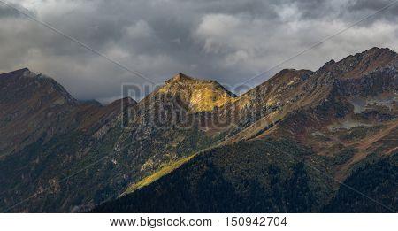Ridge in morning sunburst. Greater Caucasus Mountain Range. Caucasus mountains. Karachay-Cherkessia. Russia.