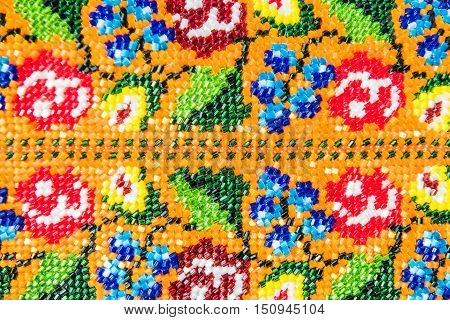 Closeup of Beaded Jewlery Ornament with flowers