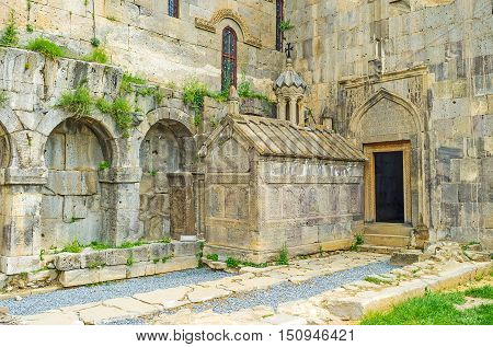 The tiny Funeral Chapel next to the St Gregory and St Peter and Paul Churches is covered with rows of medieval khachkars with traditional religious and decorative reliefs Tatev Monastery Syunik Province Armenia.