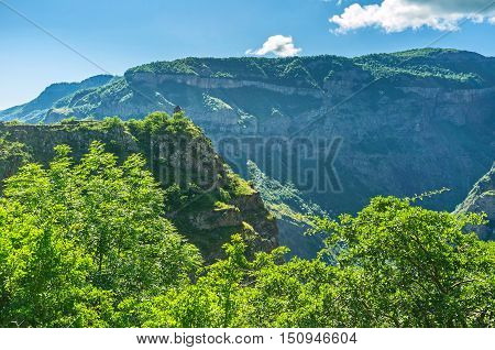 The medieval Bell Chapel on the steep rocky overlooks the mountains around deep Vorotan Gorge and Tatev Monastery Halidzor village Syunik Province Armenia.