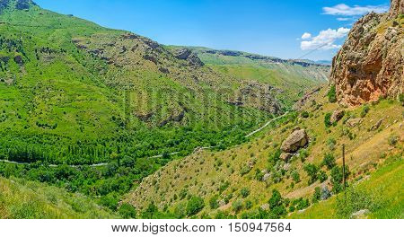 Panorama of Amaghu river canyon surrounded by massive red rocks covered with juicy greenery Vayots Dzor Armenia. poster