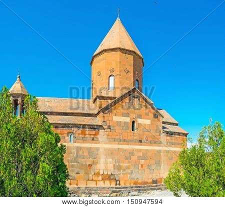 The red tuff Surb Astvatsatsin (Mother of God) Church of Khor Virap Monastery located on the hillock in Pokr Vedi village Armenia.