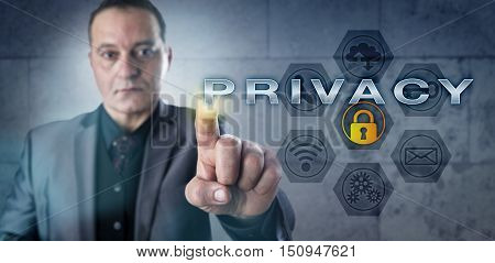 Determined mature businessman touching PRIVACY on an interactive screen. Information security concept for data privacy identity management digital rights and confidentiality of electronic contents.