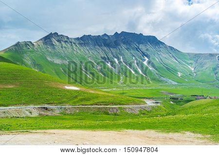 The tiny snowfields on the of the sharp mountain on Cross Pass Gudauri Georgia.