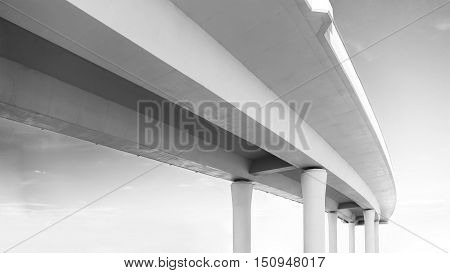 Underside of an elevated road in black and white colors