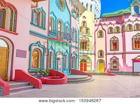 The colorful mansions decorated with numerous painted details and scenic patterns Izmailovsky Kremlin Moscow Russia.