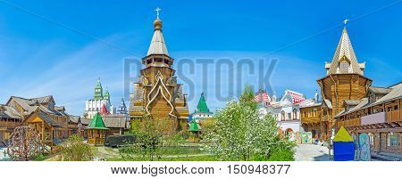 Panorama with the tallest in Russia timbered St Nicholas Church surrounded by the traditional mansions museums towers alcoves and with the tiny garden in front of it Moscow.