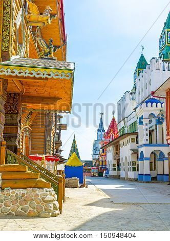 The colorful mansions wooden carved palaces and churches old-styled sculptures and patterns towers and weathervanes give to Izmailovsky Kremlin atmosphere of the fairy tale Moscow Russia.