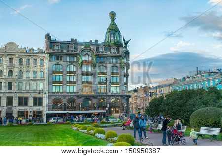 ST PETERSBURG RUSSIA - OCTOBER 3 2016. Zinger House on Nevsky Prospect and Kazan square with people walking along in autumn sunset in St Petersburg center Russia. Architecture city scape