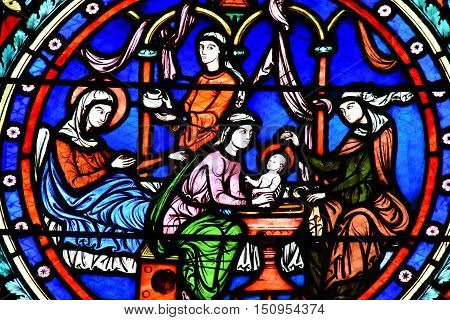 Poissy France - august 6 2016 : stained glass window of the historical collegiate church where the king Saint Louis was baptised