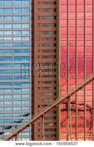 Geometrical patterns on building facade with sky and cloud reflections shot in Las Vegas