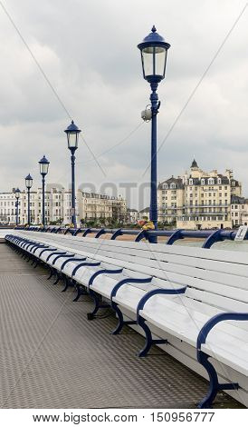Deserted Seats On Pier In Eastbourne Uk