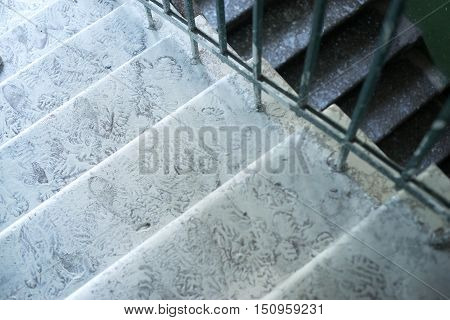 The steps covered in whitewash, Shoe prints, dirt. Renovation of the house.