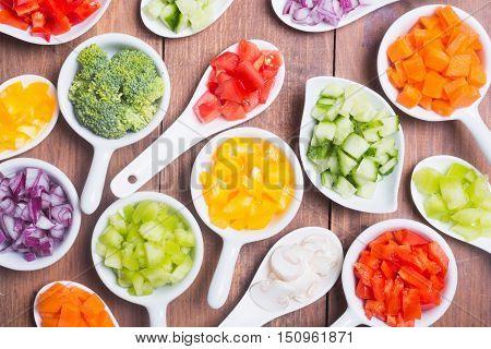 Sliced of vegetables ( pepper tomato mushrooms broccoli carrots cucumber onions )