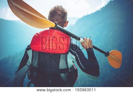 Kayak Trip Ready. Kayaker Preparing For Kayak Trip. Closeup Photo. Kayaker with Paddle.