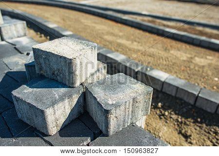 Paving Bricks Closeup. Brick Cobbles. Paving Works.