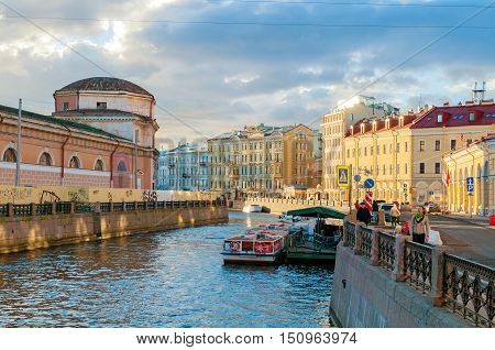 ST PETERSBURG RUSSIA-OCTOBER 3 2016. Embankment of Moika river and historic buldings in St Petersburg Russia. Archtiecture sunset landscape of St Petersburg Russia